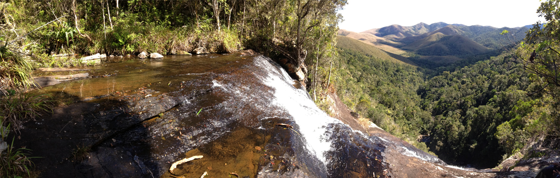 Rainforest vista from waterfall towards the deforested hills on the edge of Zahamena National Park in Madagascar